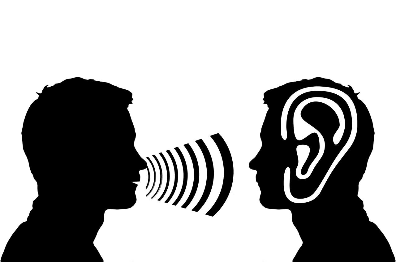 Grafik von zwei männlichen Silhouetten im Profil, einer spricht, einer hört zu